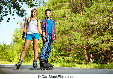 Summer sport - Portrait of a charming teenage couple...