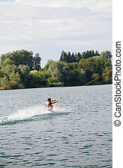 summer sports. a young woman water skiing