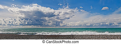 summer, stone beach, sea Blue clear, good weather, people are happy, Sunny cloudy day