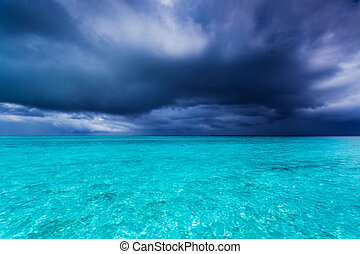 Summer storm during rain season in tropics over ocean