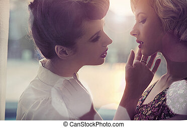 Summer style portrait of a two young ladies