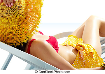 Summer style  - Girl sunbathing in chaise lounge