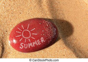 Summer sun on a pebble beach