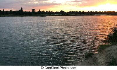 summer sunet on the blue lake