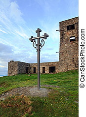 Summer sunrise observatory ruins view on Pip Ivan mountain top with christianity cross near (Chornogora Ridge, Carpathian, Ukraine)