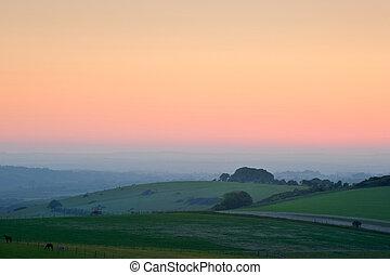 Summer sunrise over English countryside rural landscape