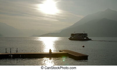 summer sunset como lake ferry - Mountains in the background...