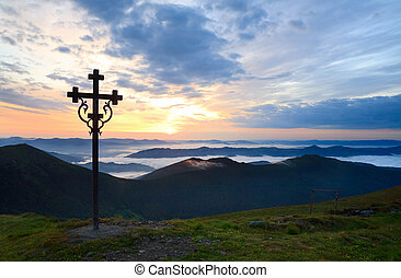 Summer sunset twilight view from Pip Ivan mountain top with christianity cross near(Chornogora Ridge, Carpathian, Ukraine)