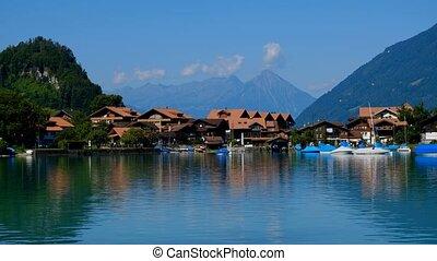 Summer Switzerland landscape. Brienz lake near Isetwald...