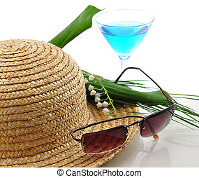 summer theme - a straw hat with sunglasses , cocktail and...