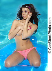 Summer time - beautiful brunette girl wearing bikini in the...