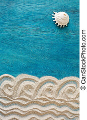 Summer time concept with design sand and single sea shells as a SUN on a blue wooden background, top view