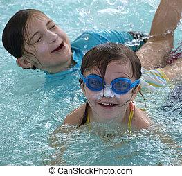 Summer time fun in the water - Sisters having lots of fun...