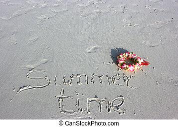 Summer time inscription and sun wreath on the sand