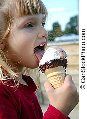 Summer Time - Little girl eating icecream cone.