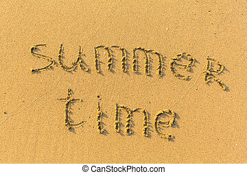 Summer time - text written on sandy