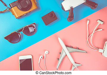 Summer Travel technology accessories flat lay on white wood