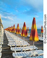 Summer Umbrellas - A lot of yellow summer umbrellas. It`s ...