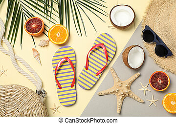 Summer vacation accessories on two tone background, top view