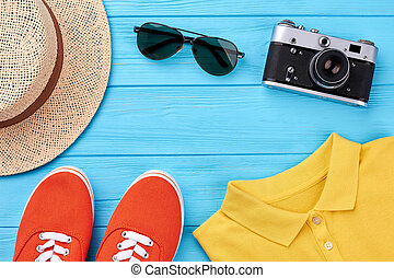 Summer vacation background, bright clothing. Hat, shoes,...