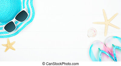 Summer vacation beach accessories banner on a white wood background with copy space