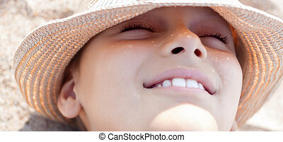 summer vacation child face happy smile close up straw hat outdoo