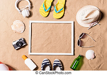 Summer vacation composition. Picture frame, hat and other stuff