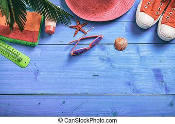 Summer vacation concept on blue background - top view