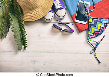Summer vacation concept on white background - top view