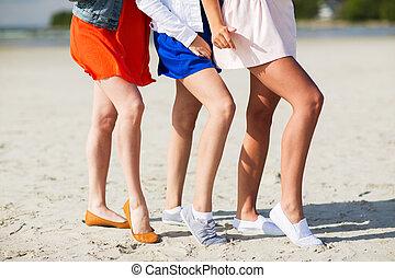 close up of women legs posing on beach
