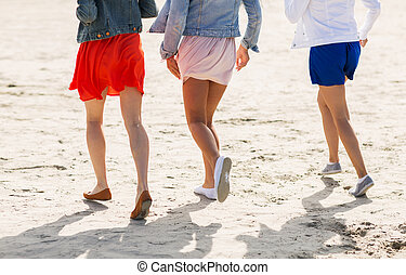 close up of women legs running on beach