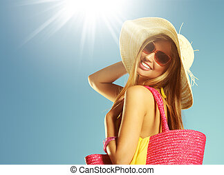 Summer vacation woman - Smiling young woman against blue ...