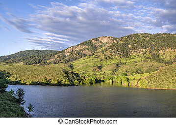 summer view of a lake at Rocky Mountains foothills