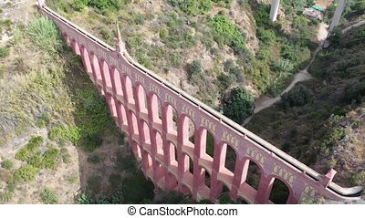 Picturesque view of Eagle Aqueduct across Barranco de la Coladilla canyon, Andalusia, Spain
