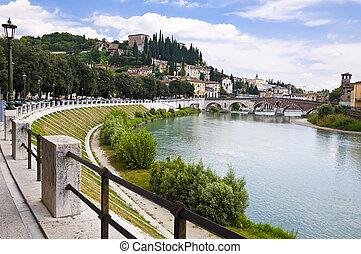 Adige River Embankment in Verona, Italy - Summer view of the...
