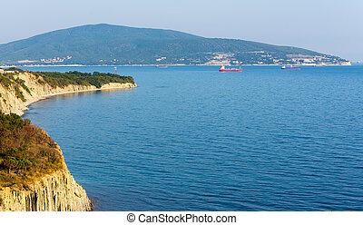 Summer view seacoast. Warm sea and beautiful nature. Bay in Novorossiysk. Black Sea