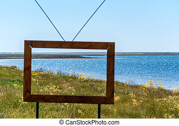 Summer view with field and lake through TV frame
