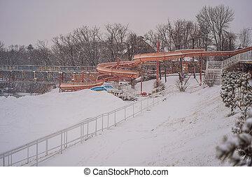 Summer water park in winter under the snow