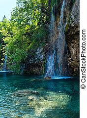 Beautiful summer waterfalls and limpid lake view in Plitvice Lakes National Park (Croatia)