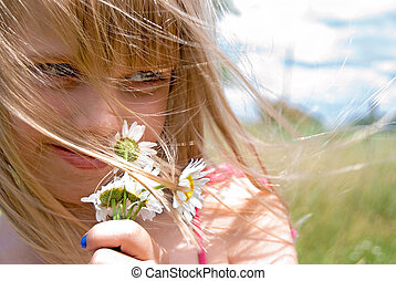 Summer Wind - Young girl with daisy bouquet in the wind.