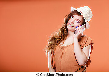 Summer woman talking on mobile phone.