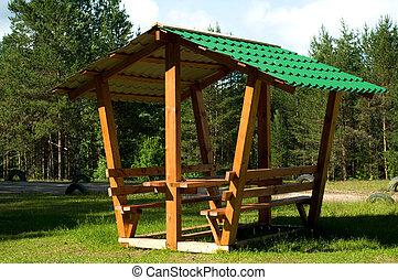 Green summerhouse in a beautiful park setting