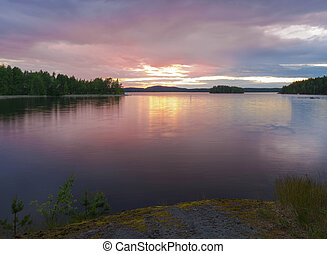 Calm lake scenery in summernight after sunset