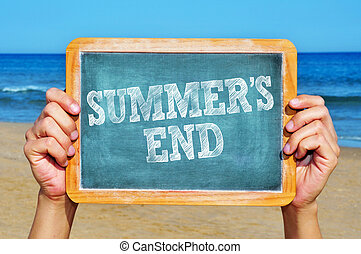 summers end - someone holding a blackboard with the sentence...
