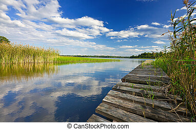Summer's lake scenery with wooden bridge