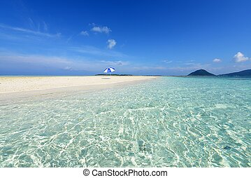 Summertime at the beach - The cobalt blue sea and blue sky ...