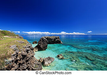 Tropical islands on the horizon over clear blue water of the coral lagoon