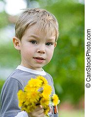 Summertime - Little kid with bunch of dandelions