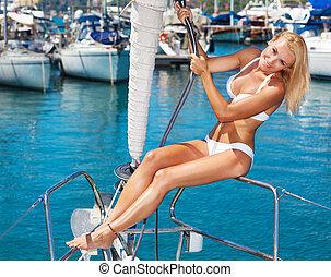 Summertime sailing vacation - Happy female tourist, having...