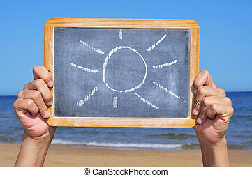 summertime - someone holding a blackboard with a sun drawn ...